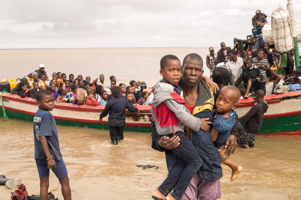 UPDATED WITH VIDEO: Cyclone Idai survivors arrive by rescue boat in Beira, Mozambique