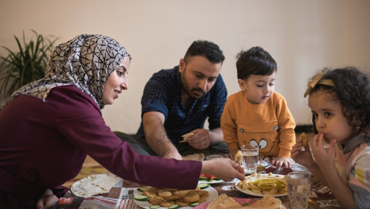Amal eating with family