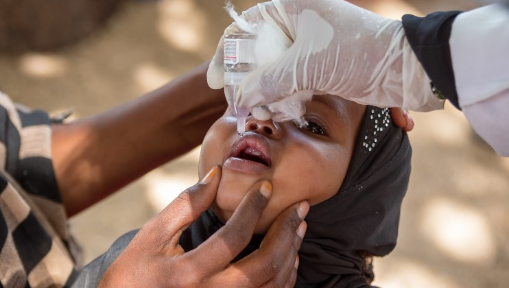 A 10 months old child receives the Polio vaccine at Dalow Mobile Clinic