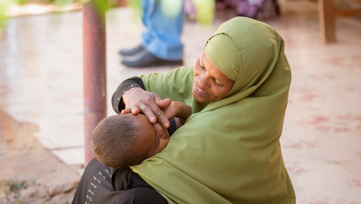 A mother awaits her son to be attended to at the Allaybaday Clinic Outpatient Department