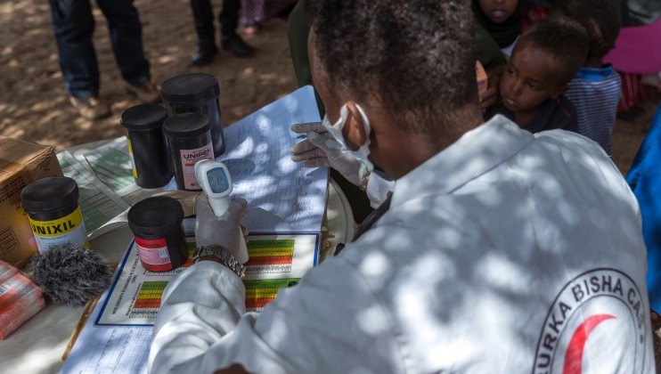 A nurse at Dalow Mobile Clinic, in Sahil region, records a patient's body temperature