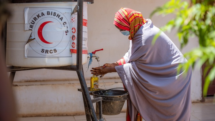 Amram Ismail, a 24 year old pregnant mother of 5, washes hands as part of the Covid  19 protocols, prior to receiving antenatal care at the Allaybaday Clini