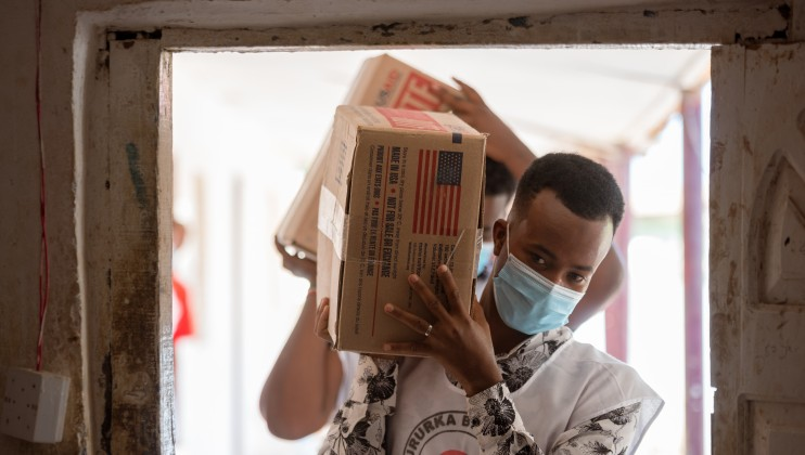 SRCS volunteers ferry delivered food supplements to the store at the Allaybaday Clinic
